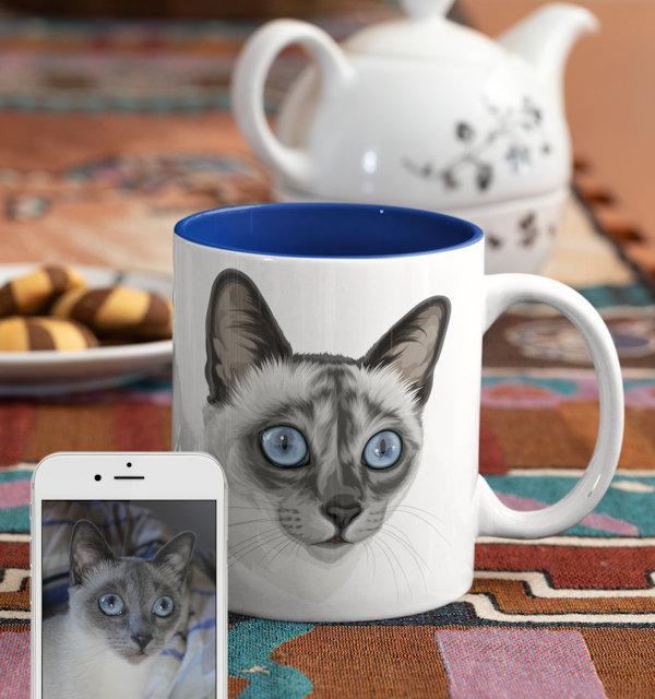 Katze auf Tasse