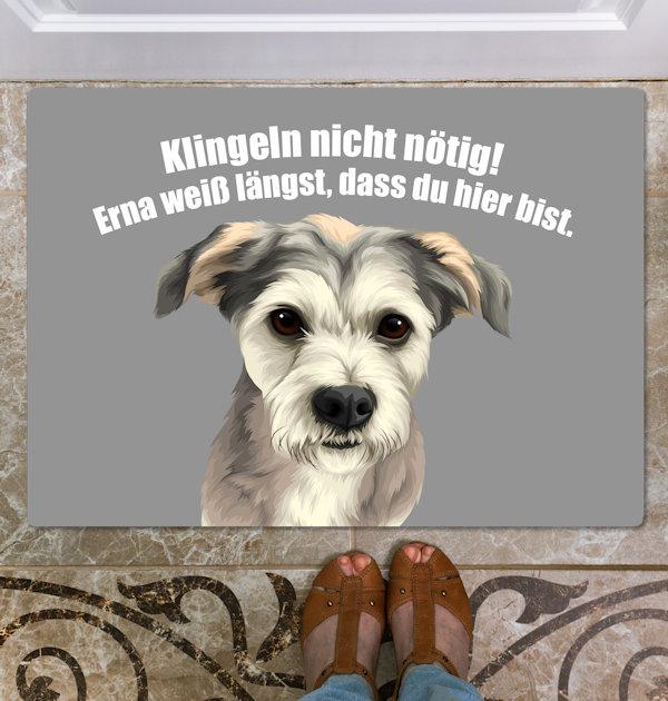Hund auf Fußmatte