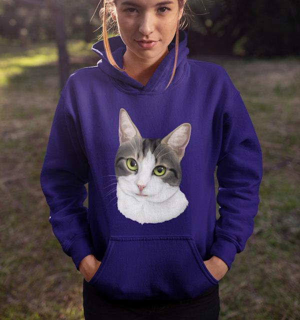 Katze auf Pullover